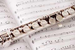 FLute. On top of sheet music Stock Photos