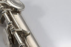 Flute on white background. Flute keys on white background Royalty Free Stock Photos