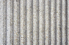 Fluted Concrete Background. Closeup of a fluted concrete wall for background.  Contains concrete and small stones embedded.  Textured with flutes or grooves Royalty Free Stock Photos