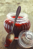 Fluted glass jar of strawberry jam Royalty Free Stock Images