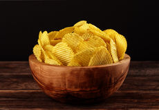 Fluted potato chips in bowl Stock Photo