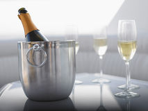 Flutes With Champagne Bottle In Ice Bucket Royalty Free Stock Photography
