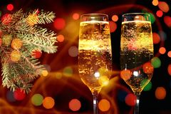 Flutes of champagne in holiday setting royalty free stock image
