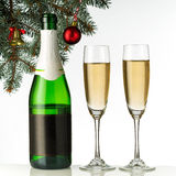 Flutes of champagne in holiday setting. Royalty Free Stock Photo