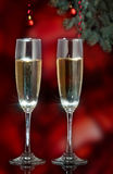 Flutes of champagne in holiday setting. Stock Photos