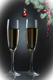 Flutes of champagne in holiday setting. Royalty Free Stock Images