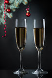 Flutes of champagne in holiday setting. Royalty Free Stock Photos
