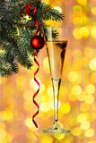 Flutes of champagne in holiday setting. Royalty Free Stock Photography