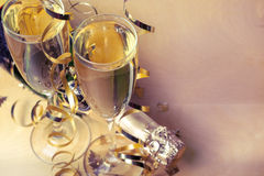 Flutes of champagne in holiday setting Royalty Free Stock Images