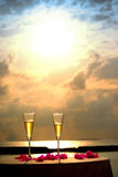 Flutes of champagne with sunset background. On the beach Stock Images