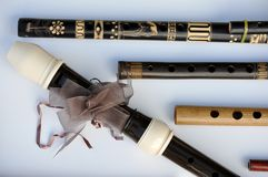 Flutes on old wood-trimmed Royalty Free Stock Image