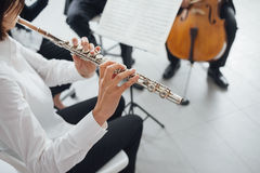 Flutist playing her instrument on stage Royalty Free Stock Photo