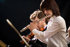 Flutist on stage Royalty Free Stock Image