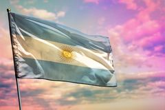 Fluttering Argentina flag on colorful cloudy sky background. Prosperity concept. Fluttering Argentina flag on colorful cloudy sky background. Argentina stock image