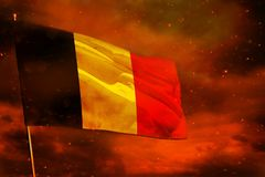 Fluttering Belgium flag on crimson red sky with smoke pillars background. Troubles concept. Fluttering Belgium flag on crimson red sky with smoke pillars royalty free stock image