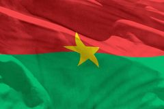 Waving Burkina Faso flag for using as texture or background, the flag is fluttering on the wind. Fluttering Burkina Faso flag for using as texture or background royalty free stock photo
