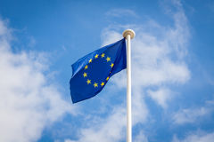 The fluttering flag of European Union on a pole Stock Photo