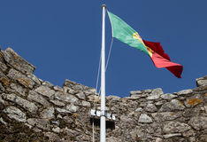 Fluttering flag over the tower of Moors in the cit Royalty Free Stock Image