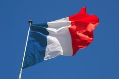 Fluttering French Flag. French flag fluttering in a brisk breeze against a bright blue sky Stock Images
