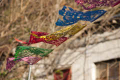 Fluttering Mexican Banner. A paper picado style banner flutters in the wind in Texas. Happy Cinco de Mayo Stock Images