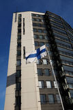Fluttering national flag of Finland beside modern building Royalty Free Stock Images