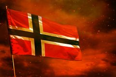 Fluttering Norway flag on crimson red sky with smoke pillars background. Troubles concept. Fluttering Norway flag on crimson red sky with smoke pillars stock photos