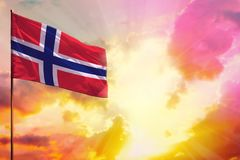 Fluttering Norway flag in top left corner mockup with the space for your text on beautiful colorful sunset or sunrise background. Fluttering Norway flag in left royalty free stock image