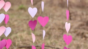 Fluttering Pink Paper Heart Garlands. Fluttering in The Wind Garlands of Pink Paper Hearts for a Creative Photo Shootn stock video footage