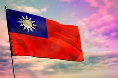 Fluttering Taiwan Province of China flag on colorful cloudy sky background. Prosperity concept. Fluttering Taiwan Province of China flag on colorful cloudy sky royalty free stock photography