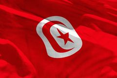 Waving Tunisia flag for using as texture or background, the flag is fluttering on the wind. Fluttering Tunisia flag for using as texture or background, the flag stock image
