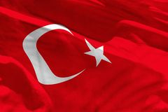 Waving Turkey flag for using as texture or background, the flag is fluttering on the wind. Fluttering Turkey flag for using as texture or background, the flag is stock image