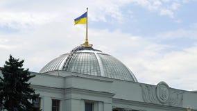 The fluttering Ukrainian flag over the parliament building in the center of Kiev. Verkhovna Rada of Ukraine