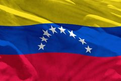 Waving Venezuela flag for using as texture or background, the flag is fluttering on the wind. Fluttering Venezuela flag for using as texture or background, the vector illustration