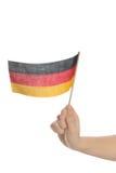 Fluttui una bandierina tedesca Fotografia Stock
