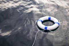 Flutuador da poupança de vida marinha no mar fotos de stock royalty free