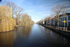 Fluwelensingel with the canal and a weeping willow without leaves in the winter in Gouda, the Netherlands. Fluwelensingel with the canal and a weeping willow royalty free stock photos