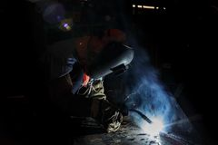 Flux cored wire arc welding process. Worker fabricate structure by flux cored wire arc welding process Stock Photography
