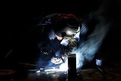 Flux cored wire arc welding process. Worker fabricate structure by flux cored wire arc welding process Royalty Free Stock Photo
