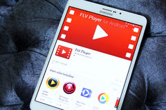 Flv player app. Downloading flv player application from google play store on samsung tablet Stock Photos