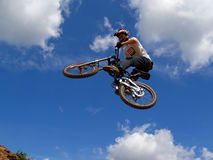 Fly [4]. Flying biker over the sky Stock Photo