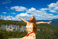 Fly. Woman enjoing life, arms wide open royalty free stock images