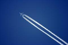 Fly. Aeroplane on the blue sky Stock Photos