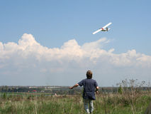 Fly. Man watching a flight of airplane model Stock Photography