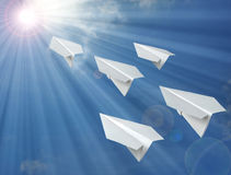 Fly. Paper airplane flying in the blue sky Royalty Free Stock Photos