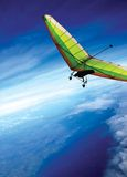Fly above the clouds. Hang gliding above the clouds royalty free stock photo