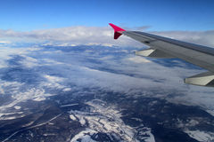 Fly above mountains Royalty Free Stock Images