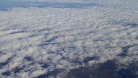 Fly above sky. Blue sky view from fly above clouds. Video clip filmed from plane