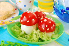 Fly agaric made from egg and tomato. Breakfast for child with fly agaric mushrooms made from boiled egg ,tomato and mayonnaise Stock Photo