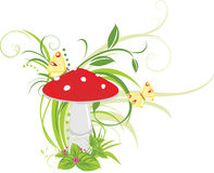 Fly agaric mushroom and butterflies Stock Image