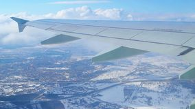 Fly by air above city. View through an airplane window. Flying over the Moscow through clouds and little turbulence stock video